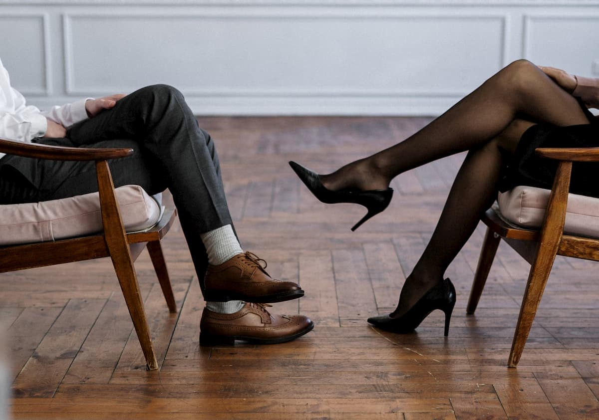 Legs of a man and woman facing each other