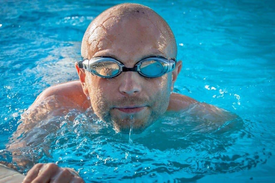 Bald man in pool