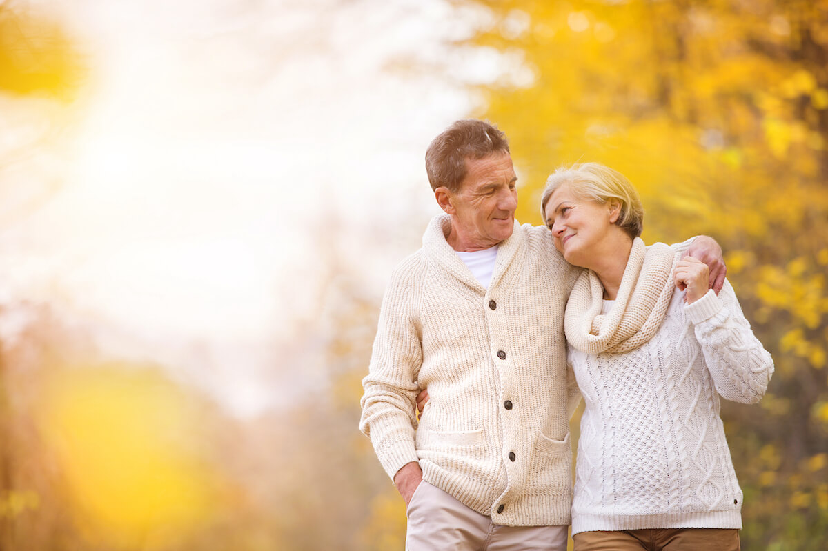 older adult couple walking peacefully during fall_Managing senior anxiety