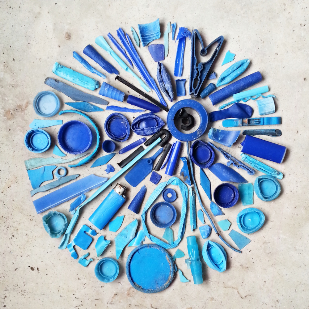 blue-plastic-pollution-collection-beach-reduce-waste-recycle-flat-lay-art-environment-global_t20_a7NQbY