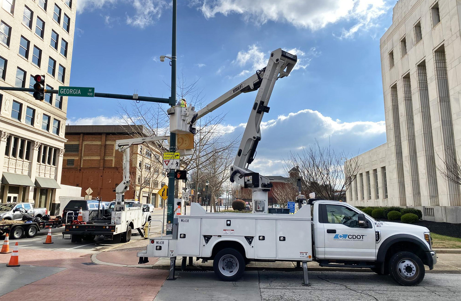 Utility truck installing an Ouster lidar sensor on a traffic pole in downtown Chattanooga Tennessee