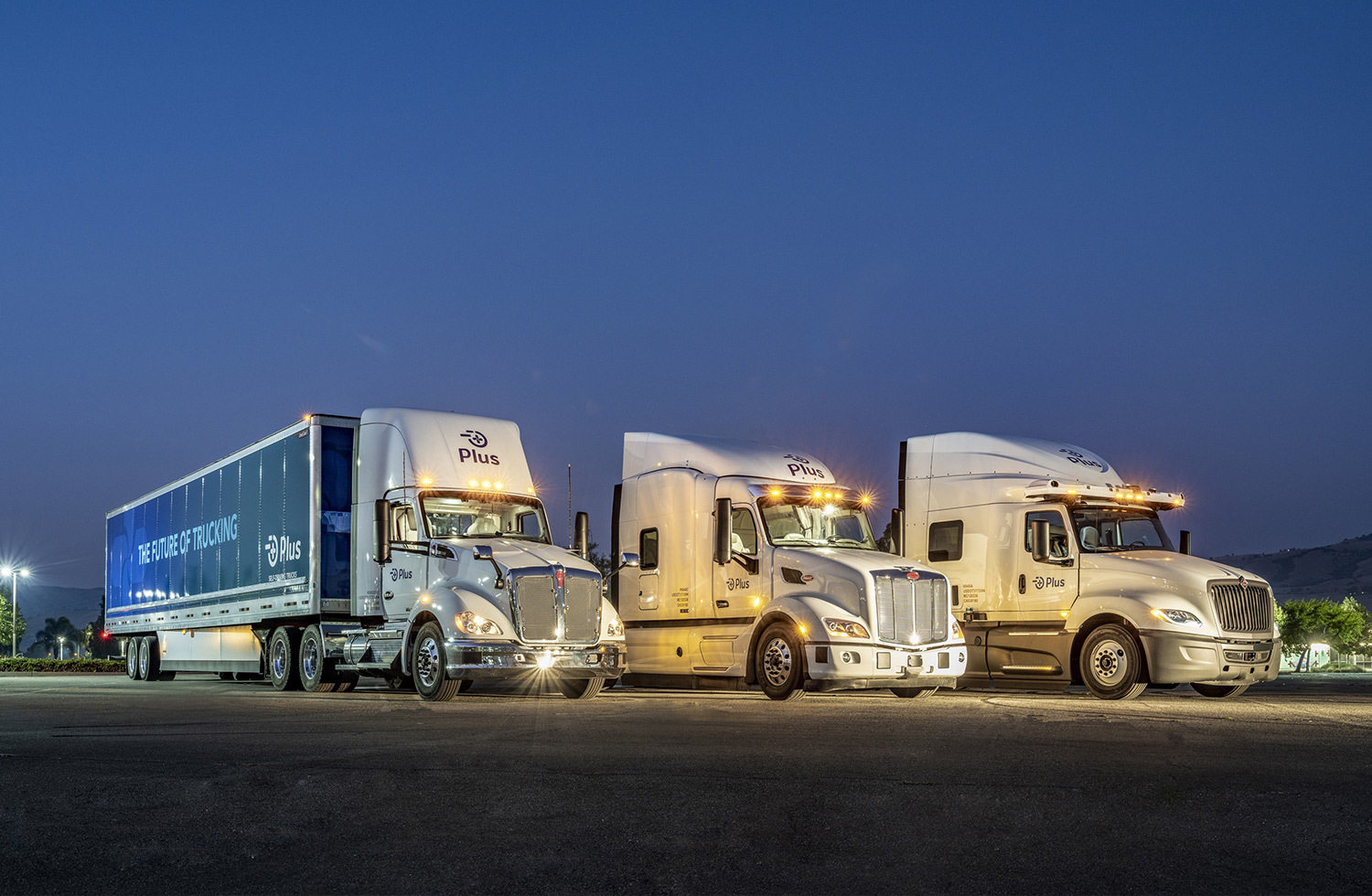 plus trucks lined up at night with ouster lidar sensors