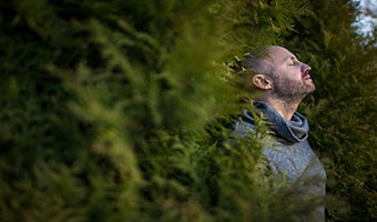 breathing exercise man breathes fresh air in nature