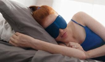 Red headed girl sleeping on the bed using Yoga Nidra For Sleep to help her sleep