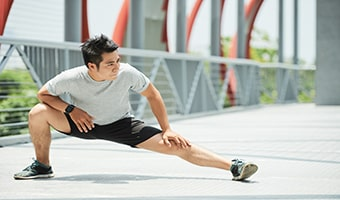 yoga for runners man doing stretching exercise
