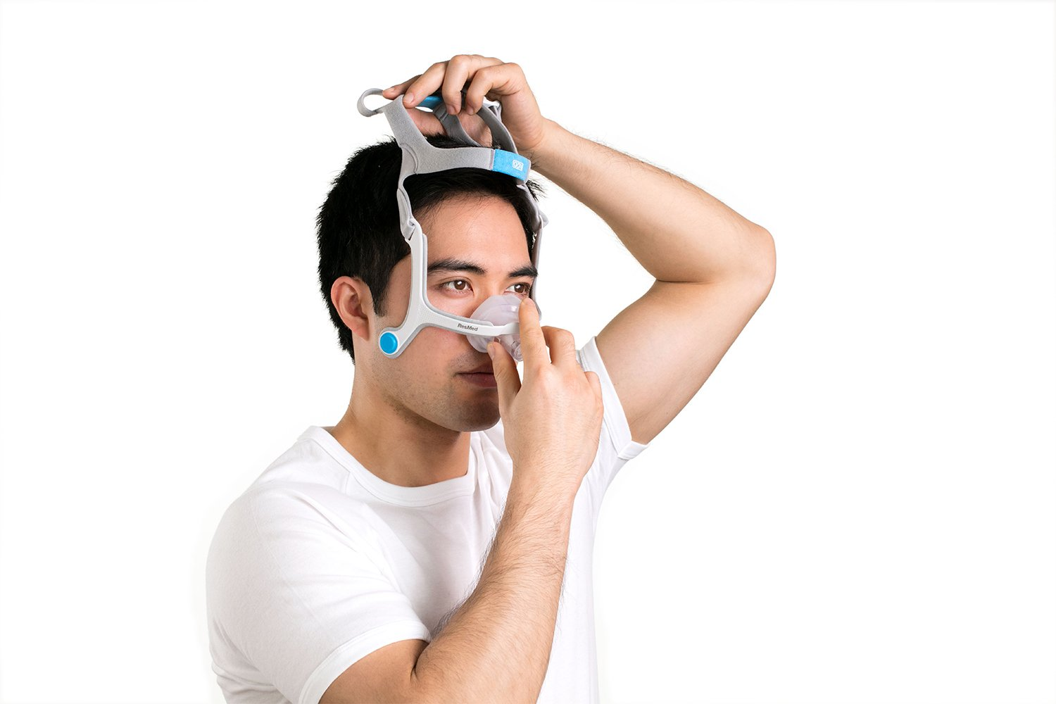 Man Trying on N20 Nasal Mask