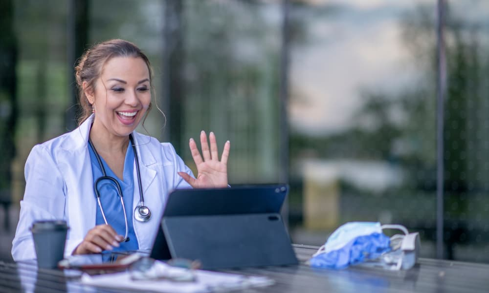 a medical professional providing telehealth care to a patient