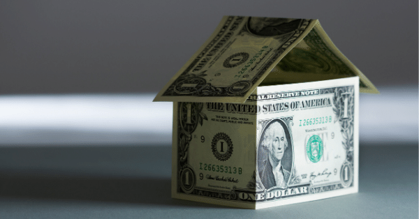 Two dollar bills that are in the shape of a tiny house